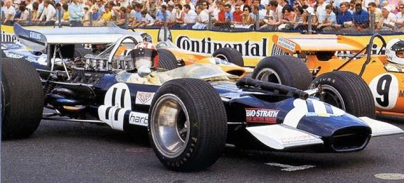 Jo Siffert, in Rob Walker's Lotus 49B and Denny Hulme, McLaren M7A, on the grid, Nürburgring 1969. Both were to retire; Siffert with suspension problems and Hulme with transmission woes.