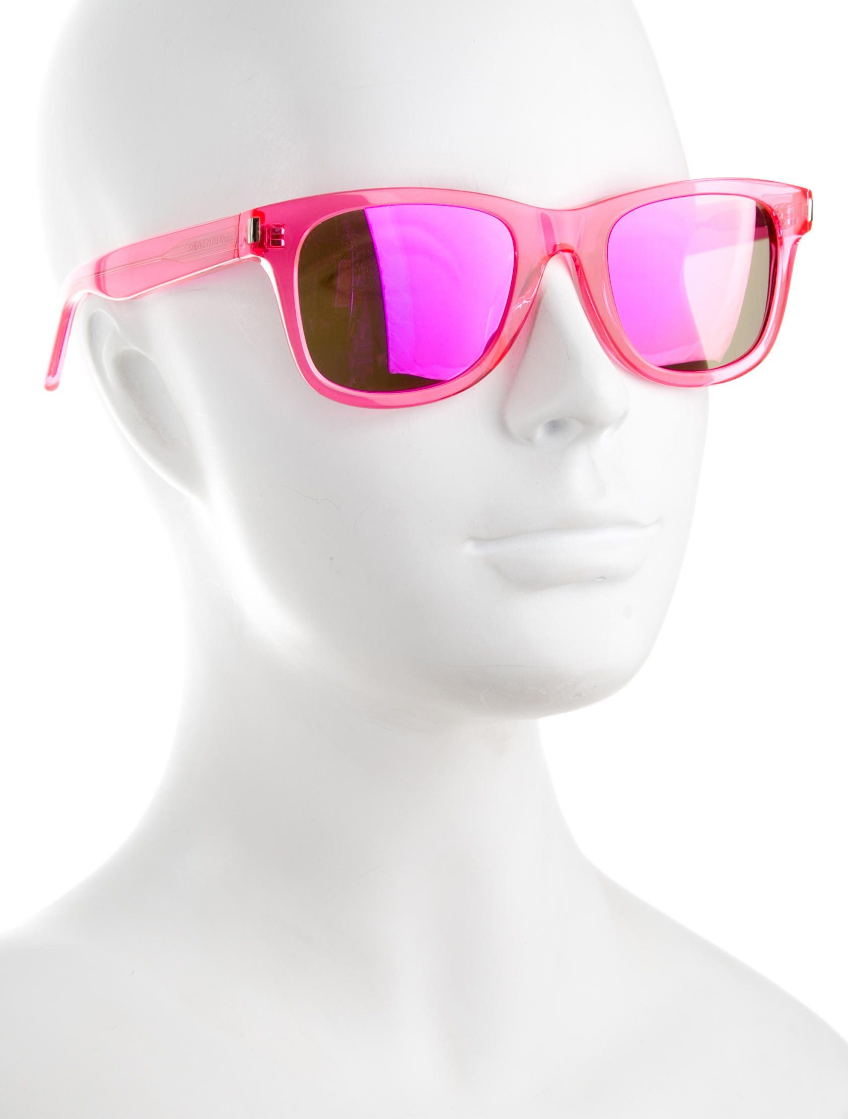 d57cd7afac Pink Saint Laurent translucent wayfarer sunglasses featuring pink mirrored  lenses and logo at temples. Includes