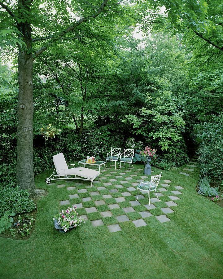 Photo of A Garden With Checkered Pavement by Pedro E. Guerrero