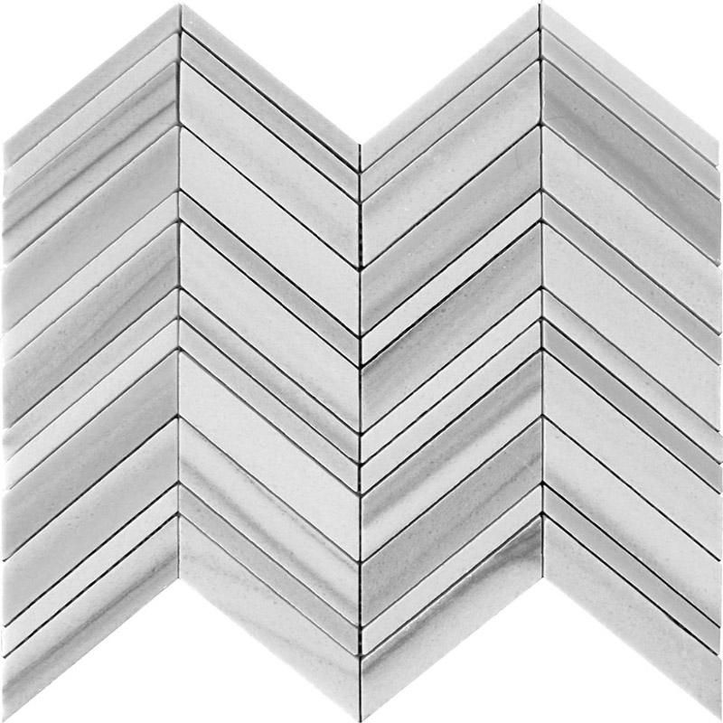 This astoundingly beautiful chevron tile made of Equator marble has the ability to make any room look instantly classy. Rows of parallelogram tiles create a V shape known as the chevron pattern, giving a playful and yet chic appeal to your space. Equator marble is a white and gray marble with linear veins, quarried in Turkey. The parallel veining makes this marble tile so unique and distinct that you can easily create an eye-catching focal point on any surface. This chevron pattern marble tile c