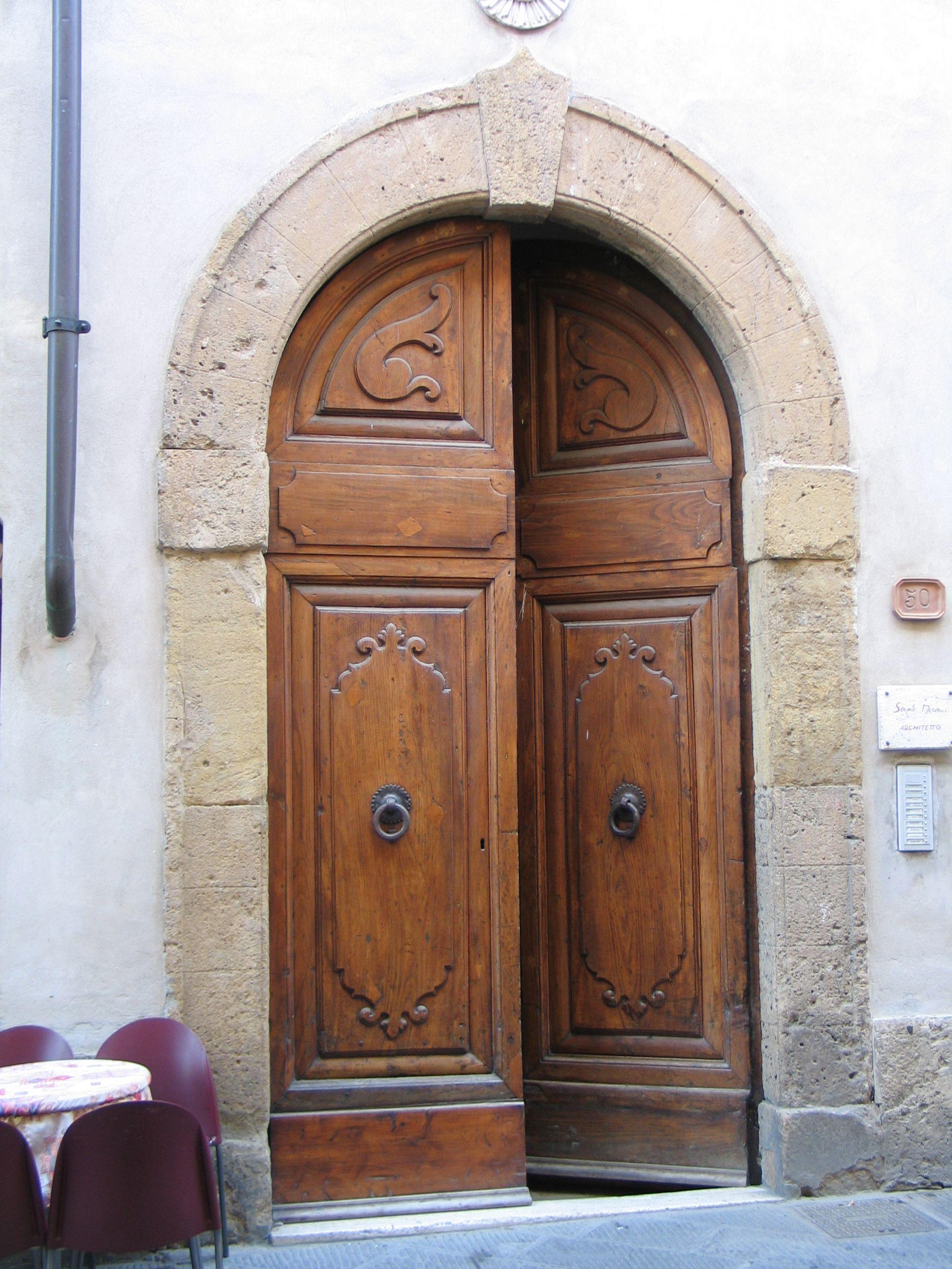 A massive wooden door in San Gimignano, Italy.