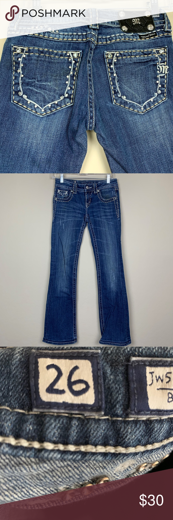 Miss Me Boot Cut Jeans SZ26 MISSING some bling on pockets Please see all pictures. Medium wash blue, Classic 5 pocket design, Zip up button front. Slight distress on hem. Good condition. Waist flat 13.5