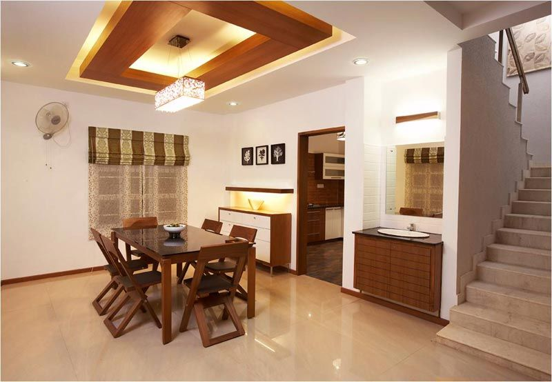 Dining room with wooden suspended ceiling savio and rupa for Residential interior design ideas