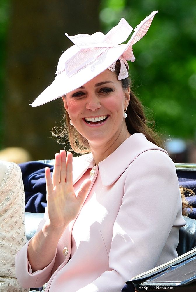 Catherine, Duchess of Cambridge rides in a carriage back to Buckingham Palace during the annual Trooping the Colour Ceremony on June 15, 2013 in London, England.