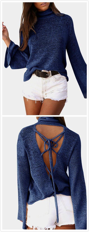 205fbf8e3e This open-knit sweater featuring a roll neckline