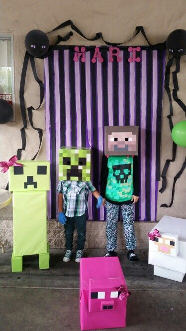 Minecraft photobooth. Made of 2 cardboards covered w/ wrapping paper and streamers. Animals made of boxes and wrapping paper. Steve head also made of a box.