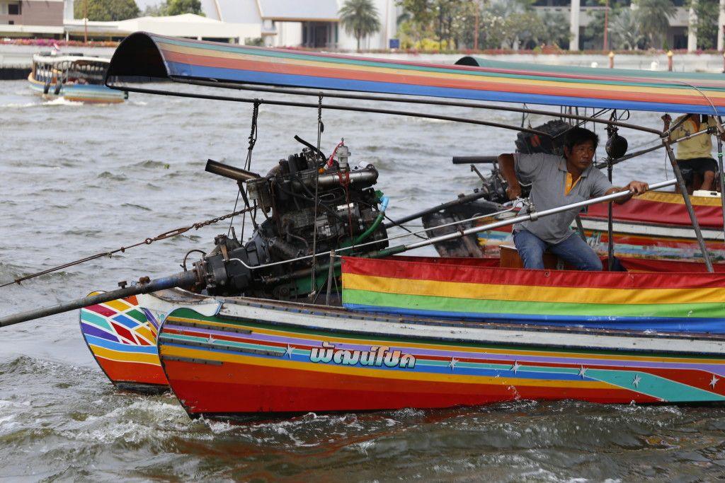 The longtail boats and their crazy motors on Chao Phraya. Bangkok, Thailand