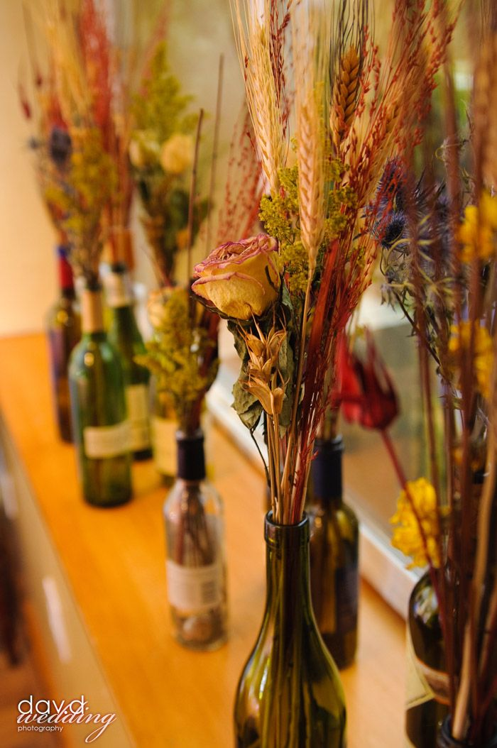 Pretty Wedding Decorations For An Autumn Using Old Wine Bottles And Dried Flowers