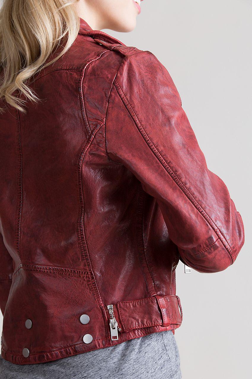 This proud, rumpled jacket showcases an asymmetrical zip