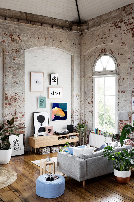 Nice living room idea with grey sofa brick wall indoor plants and abstract wall art
