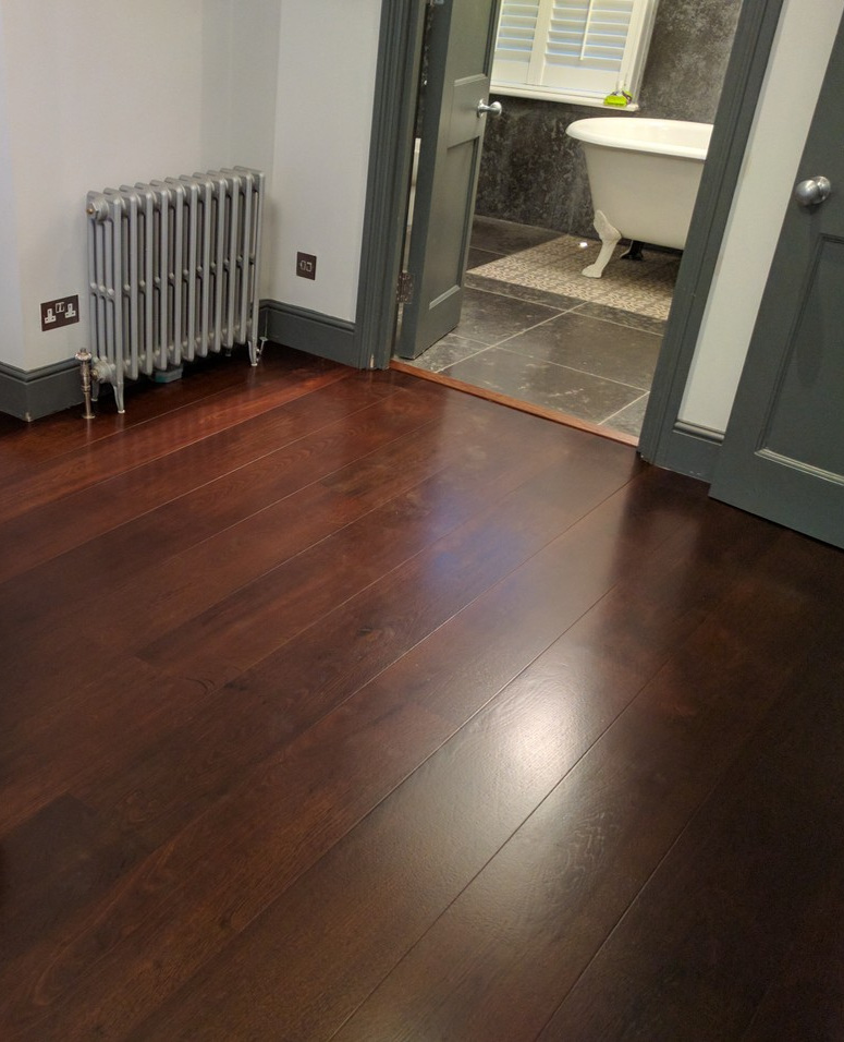 This Dark Wooden Floor Complements The Dark Tiles That Run In The Bathroom It Also Sits Beautifully With The Dark Wood Floor Design Flooring Stairs Cladding