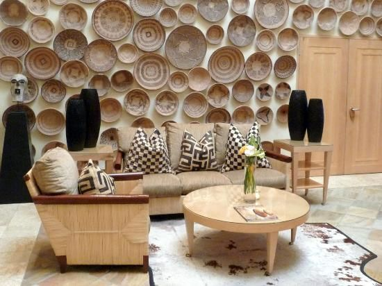 A Wall Of Baskets In One Of The Lounges The Saxon Hotel