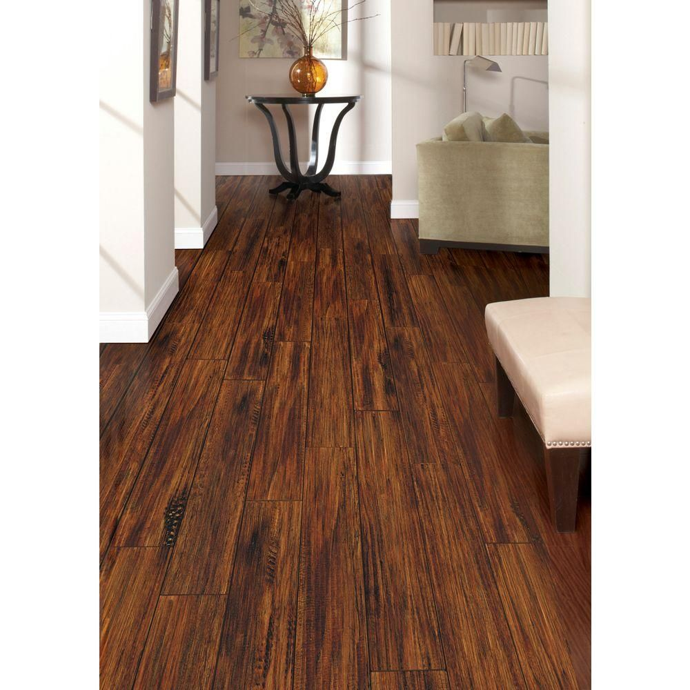 Trafficmaster Alameda Hickory 7 Mm Thick X 3 4 In Wide 50 5 8 Length Laminate Flooring 24 52 Sq Ft Case Hl707 The Home Depot