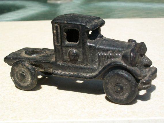 1920's / 30's Cast Iron Black Toy Truck Metal wheels. Kilgore.. $99.95, via Etsy.