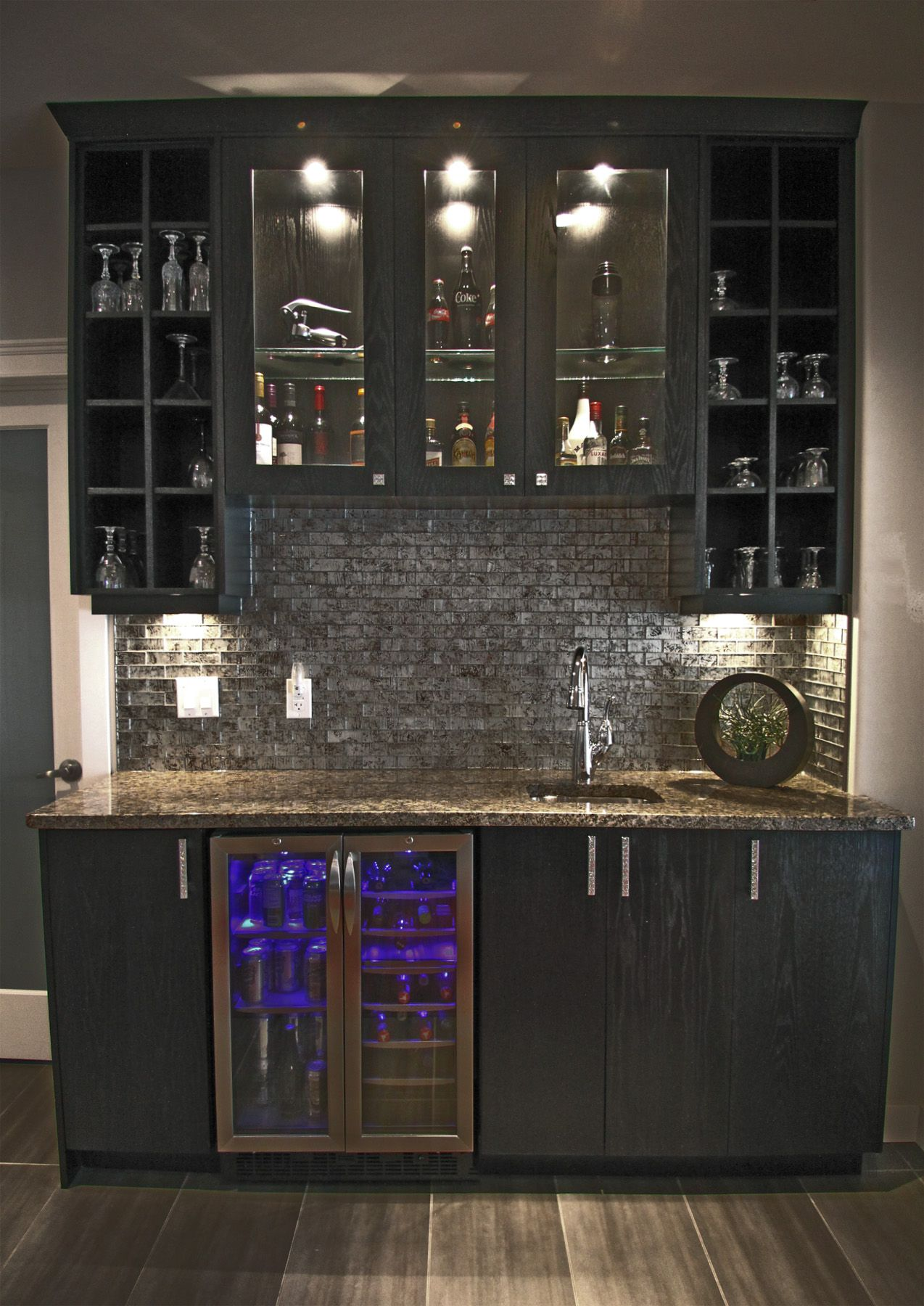 Modern Basement Wet Bar. Home Wet Bar Designs w  glass backsplash built in counter height beverage cooler