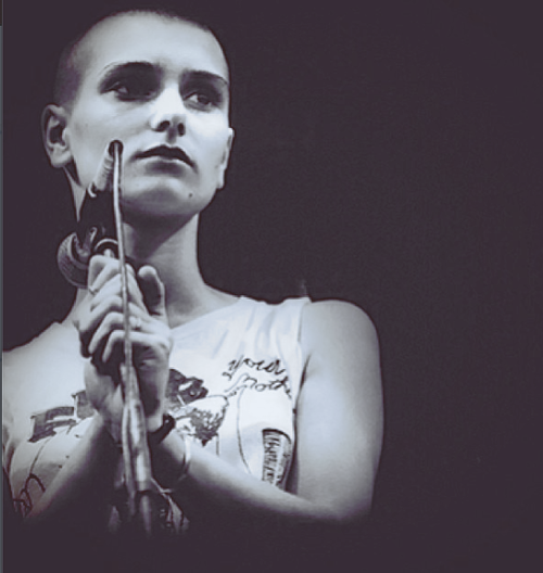 """punkpistol-seditionaries:  . Sinead O'Connor in a SEDITIONARIES 'FUCK YOUR MOTHER' tee designed by Vivienne Westwood & Malcolm McLaren .  """