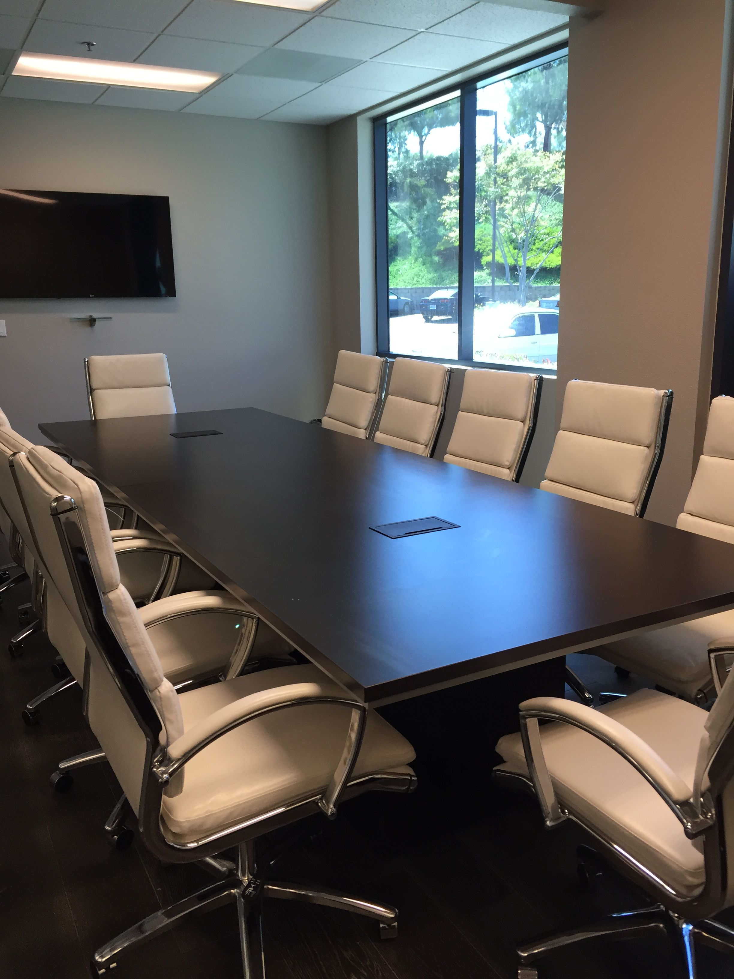 Dark Espresso Conference Room With White Leather Chairs Takes This