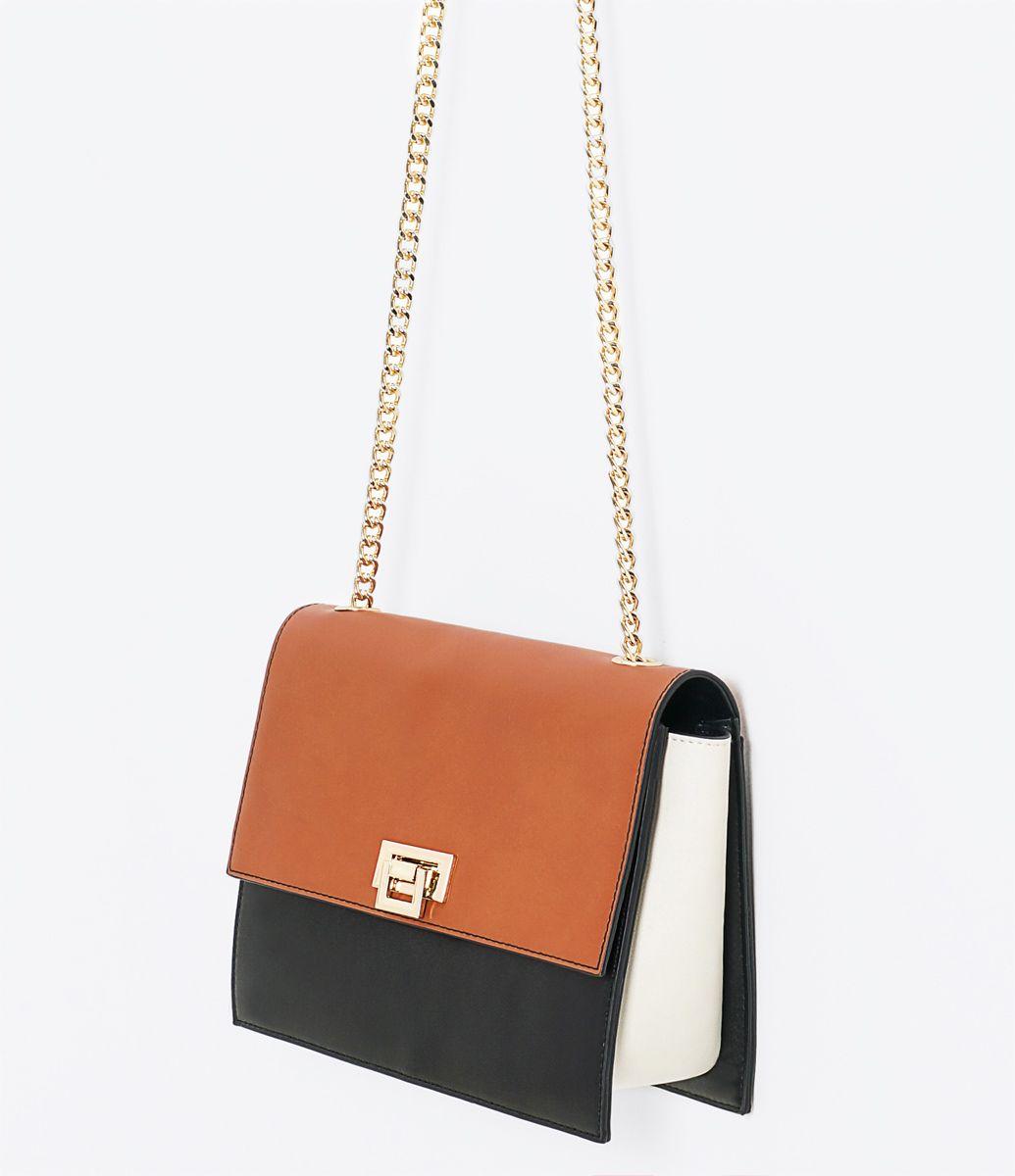 72f6c8df1 Bolsa feminina Modelo transversal Com alça de corrente Marca: Satinato  Material: sintético Composição: