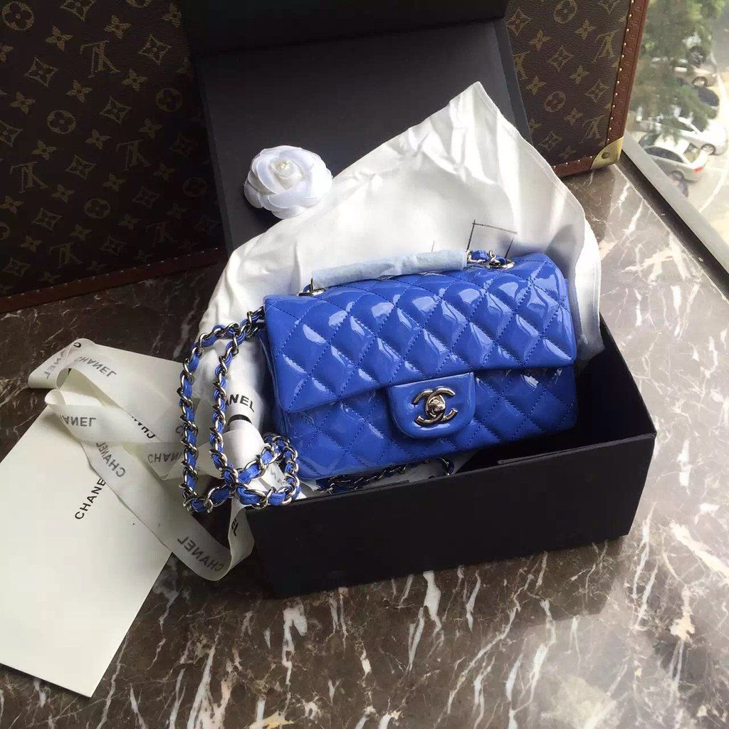 CHANEL 2016 Mini Flap Bag Blue Patent Leather for sale at https://www.ccbellavita.eu/products/chanel-2016-mini-flap-bag-blue-patent-leather