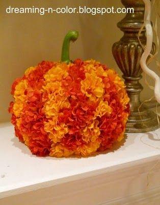 Hot  glue flowers to cheap dollar store pumpkin and add pretty stem.
