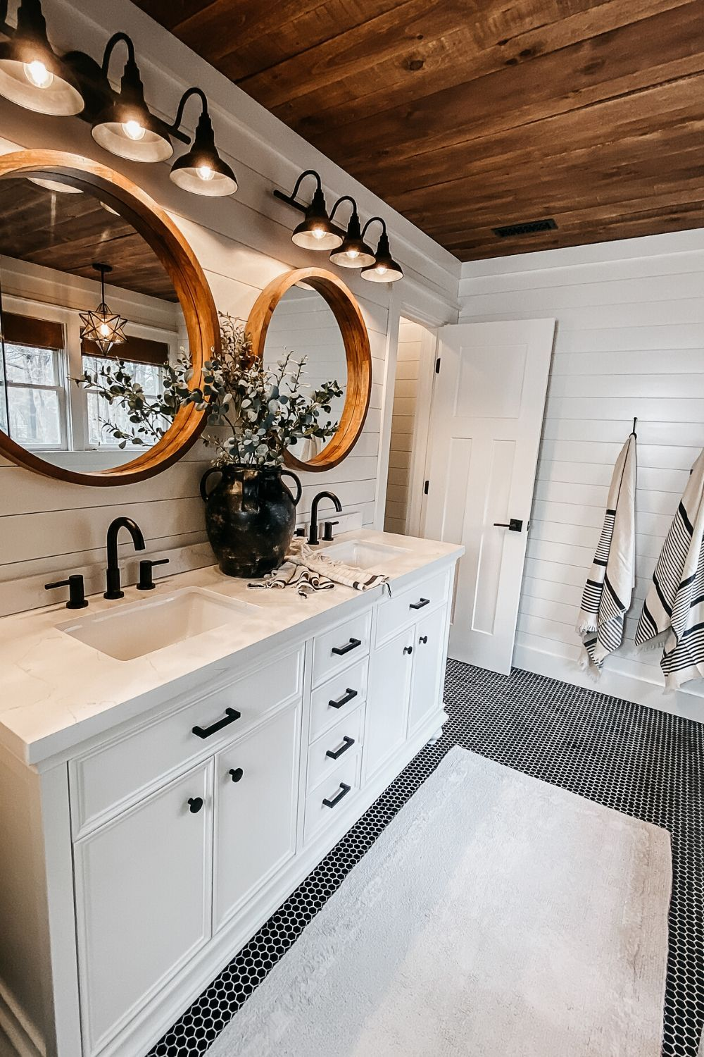 Beautiful shiplap bathroom in a modern farmhouse. Here's our completed bathroom renovation plus we answer all your questions about whether or not shiplap in a bathroom is a good idea.