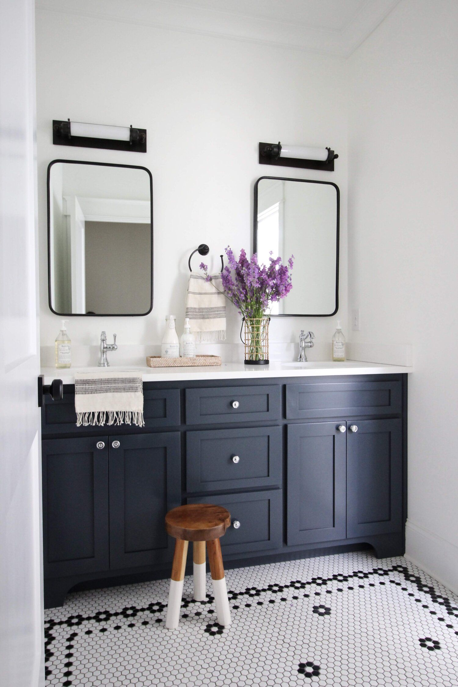 Chantilly House Laura Design Company Guest Bathroom With Navy Blue Vanity And Black White H White Bathroom Tiles Black White Bathrooms Blue Bathroom Vanity [ 2250 x 1500 Pixel ]