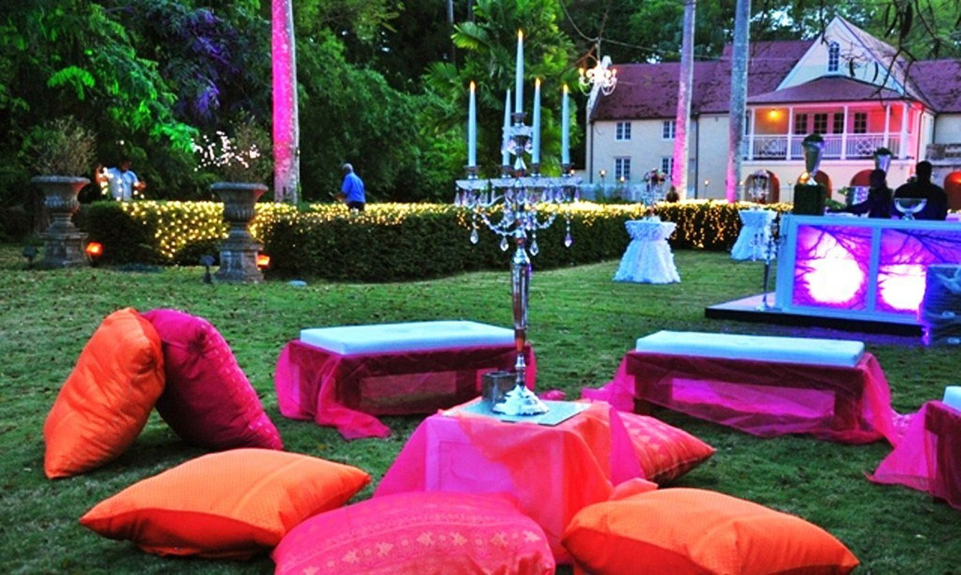 Emma Corrie Porters Great House Wedding Venue In Barbados With Jewel Tone Décor Pink And Orange Lounge Area
