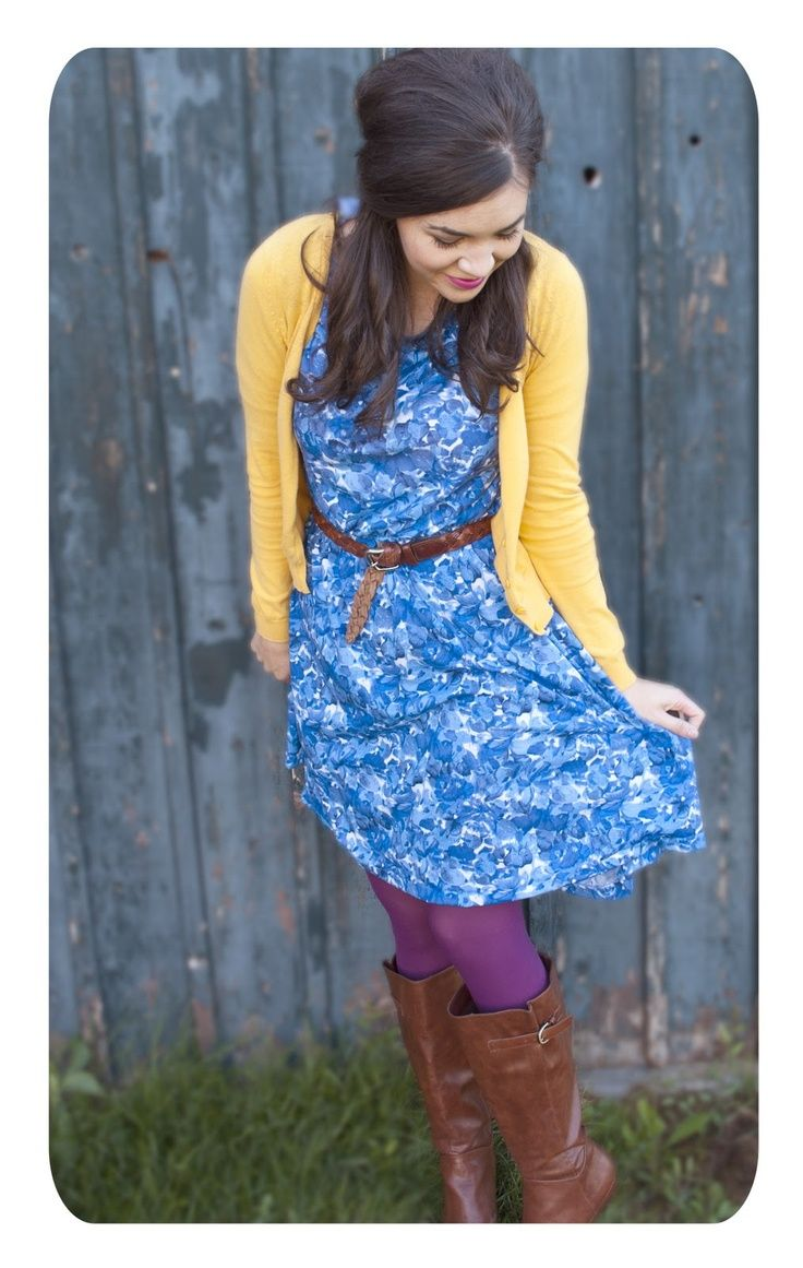 Blue printed dress, yellow cardigan, and brown riding boots