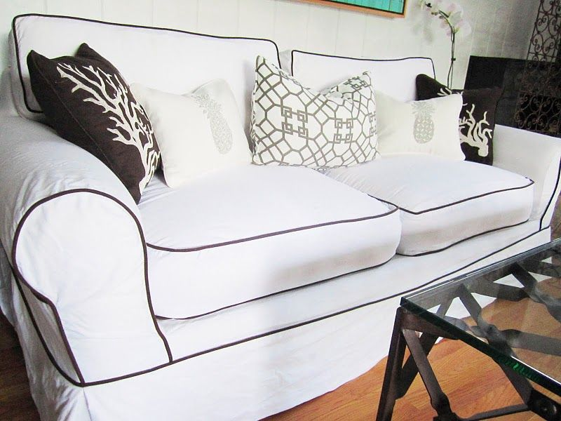 White slipcover with black piping