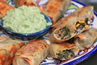 Southwest and wild rice chicken filled egg rolls with an avocado dipping sauce