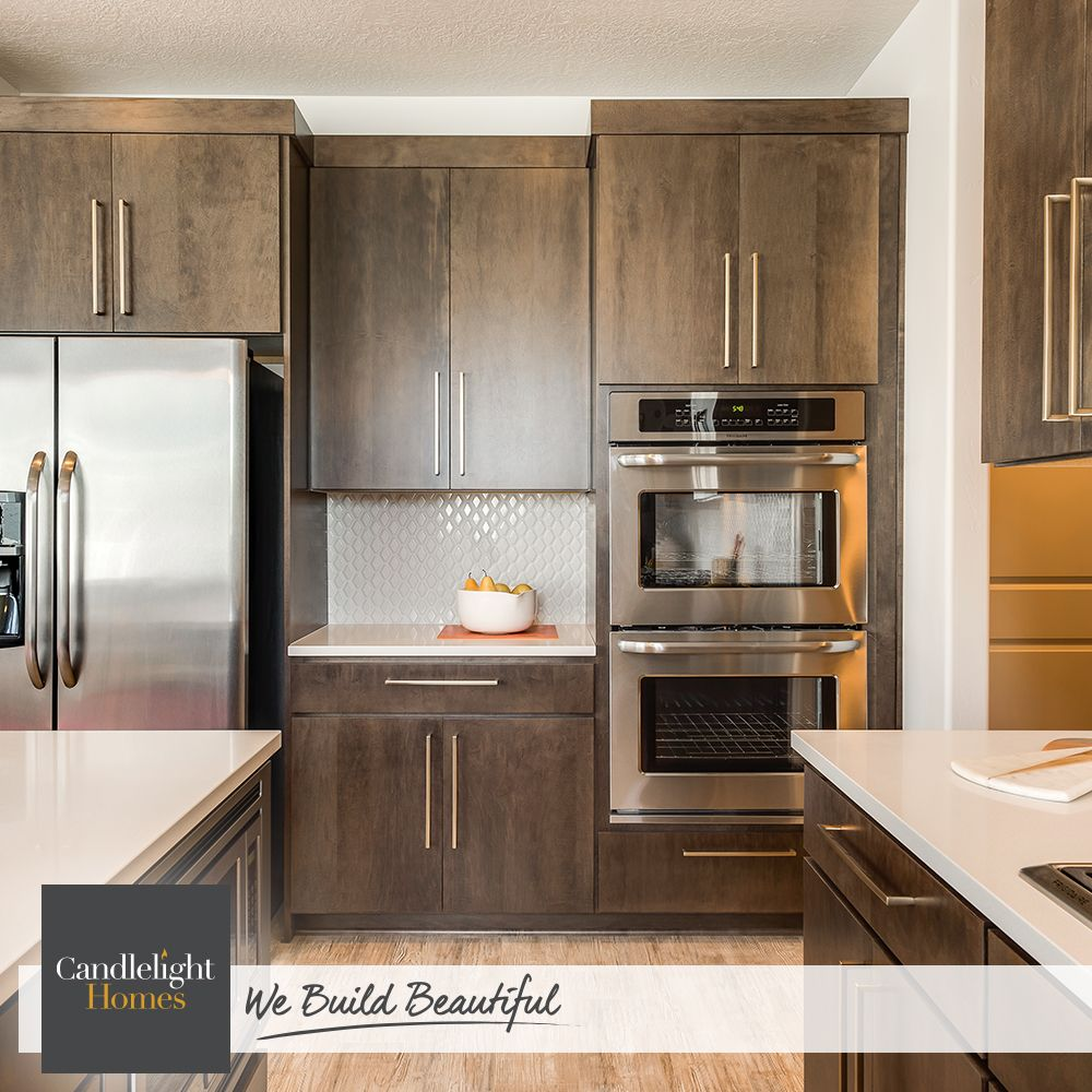 Brass Hardware Adds Handsome Detailing To Flat Panel Cabinets Kitchen Design By Candlelight Homes We Bu Kitchen Design Flat Panel Cabinets New Homes For Sale