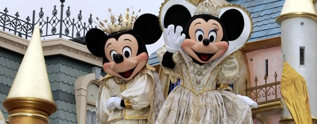 Mickey and Minnie Mouse wave during a parade at Disneyland in Anaheim, Calif. (Damian Dovarganes/AP)