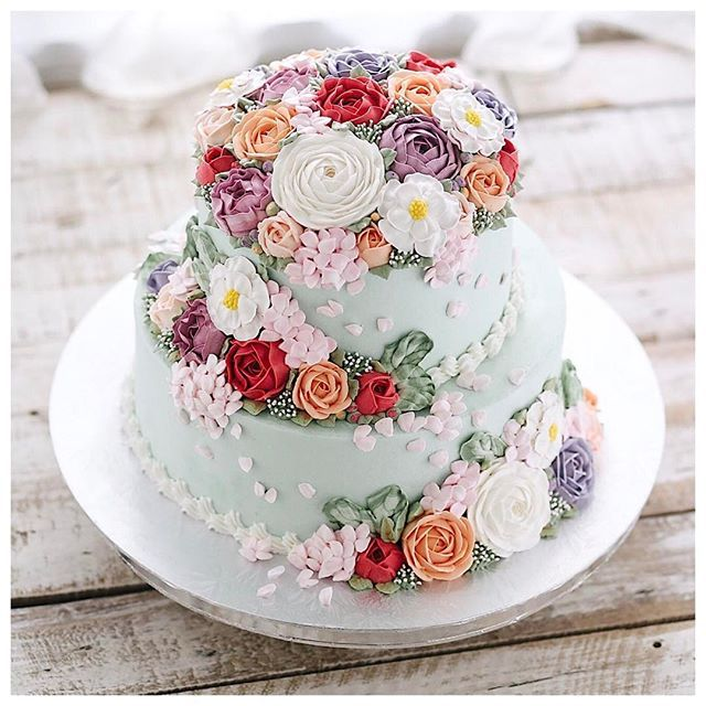 Two Tiered Flower Buttercream Cake Tiered Cakes Birthday Birthday Cake With Flowers Cake Decorating Videos