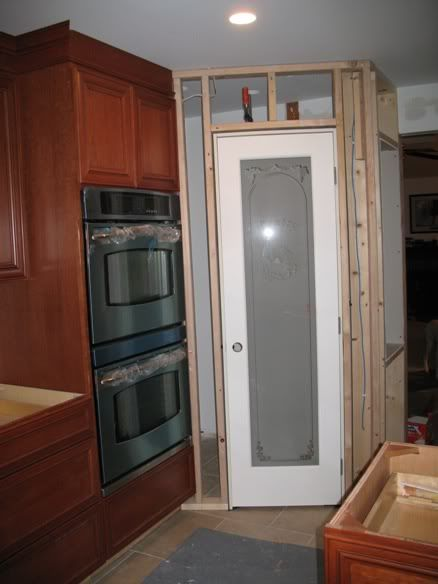 Corner Pantry Framed Out And Door Clamped In Kitchen