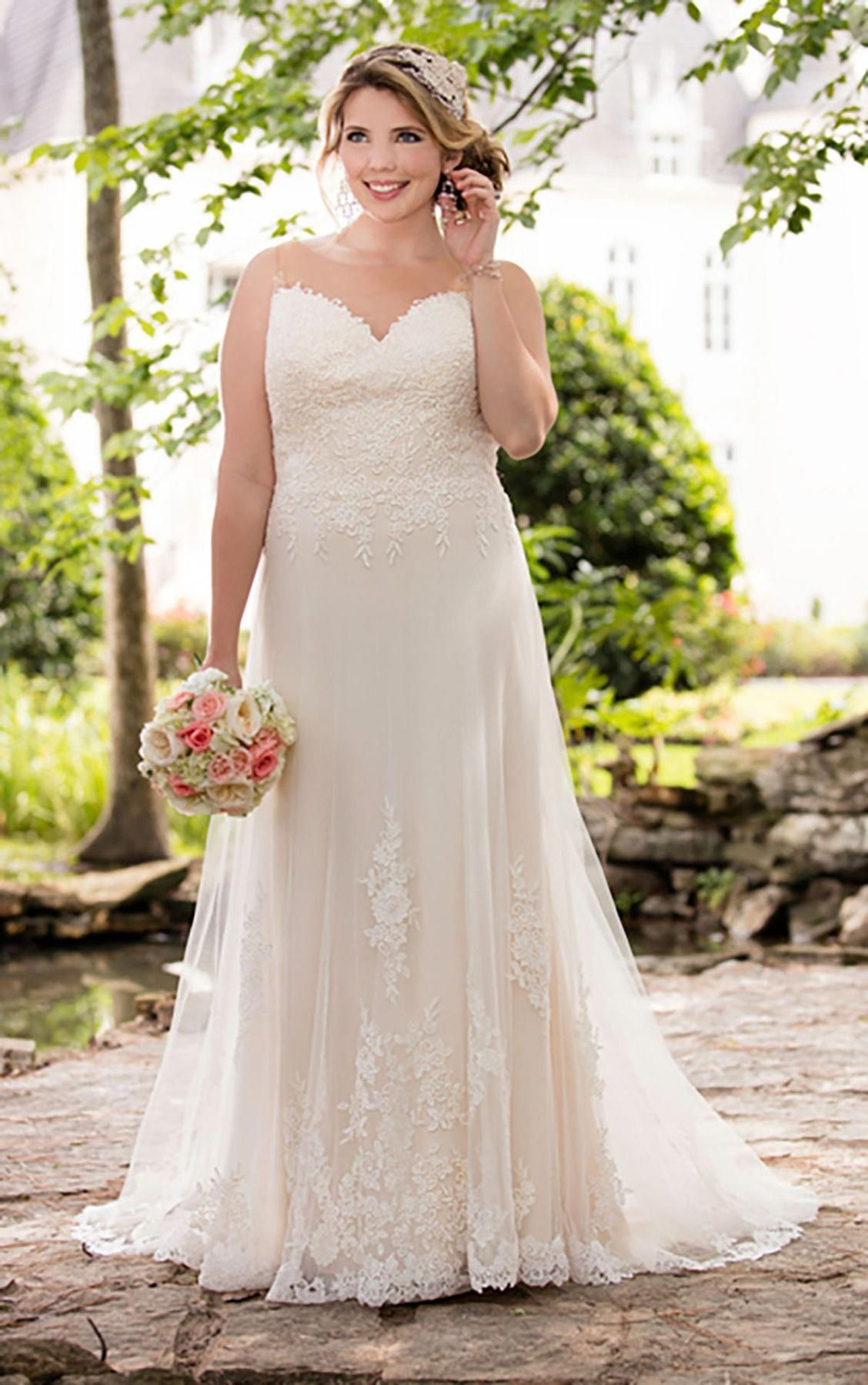 Best wedding dresses for big busts  This plus size Stella York wedding dress features the art of