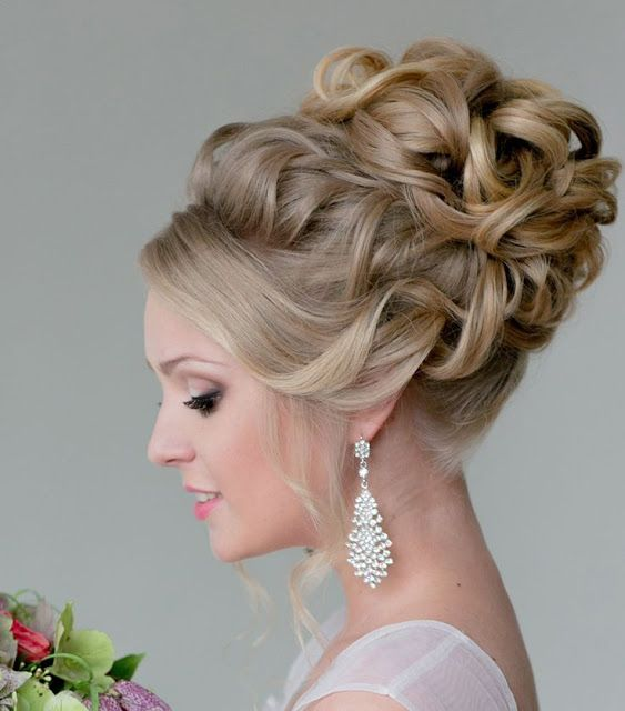 Bun Hairstyles For Curly Hair : Wedding white bride dress with elegant bun hairstyle. curly hair