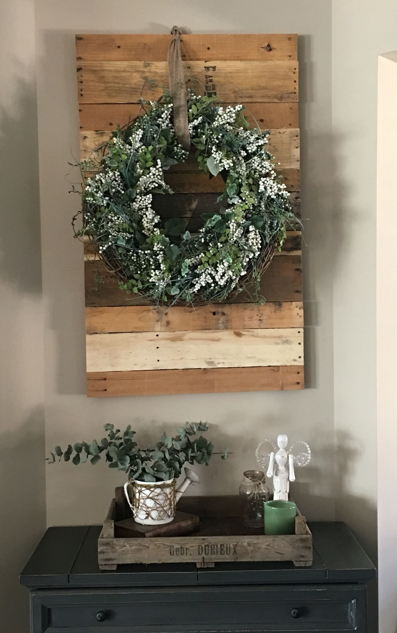 Pallet wall with hanging wreath. Also have a tray that I ...