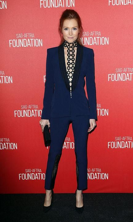 Scandal's Darby Stanchfield looked sexy and sharp in a navy blue and black Safiyaa suit and a harness