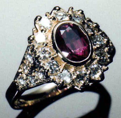 18 Karat Yellow Gold Oval Ruby and Round Brilliant Diamond Cluster-Styled Ring. A Ben Salomonsky Design. www.BenSalJeweler.com