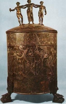 (Novios Plautios,Ficoroni Cista,bronze container,late fourth century bce.,Early Etruscan Art)It was found in Palestrina, an ancient city in Italy.But this art work is influenced by Rome's art style.Cistae is a container for women's cosmetic articles.It was a popular gift for the living and as a mortuary object,together with the engraved bronze mirror.The engraved frieze on the container tells a story of the Argonauts trip in search of  the Golden Fleece.(Kleiner,233)