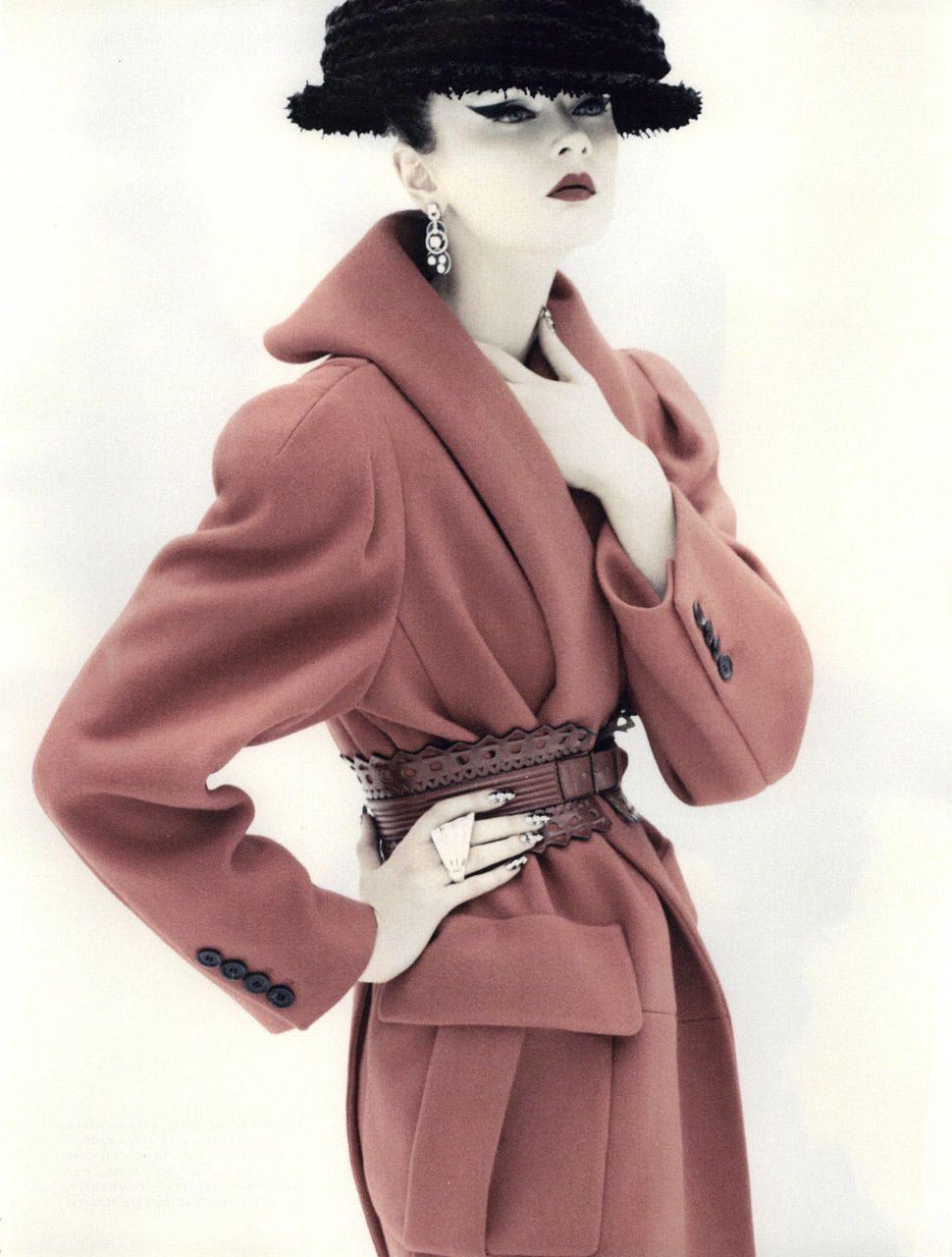 Wool coat and original cat's eye liner.