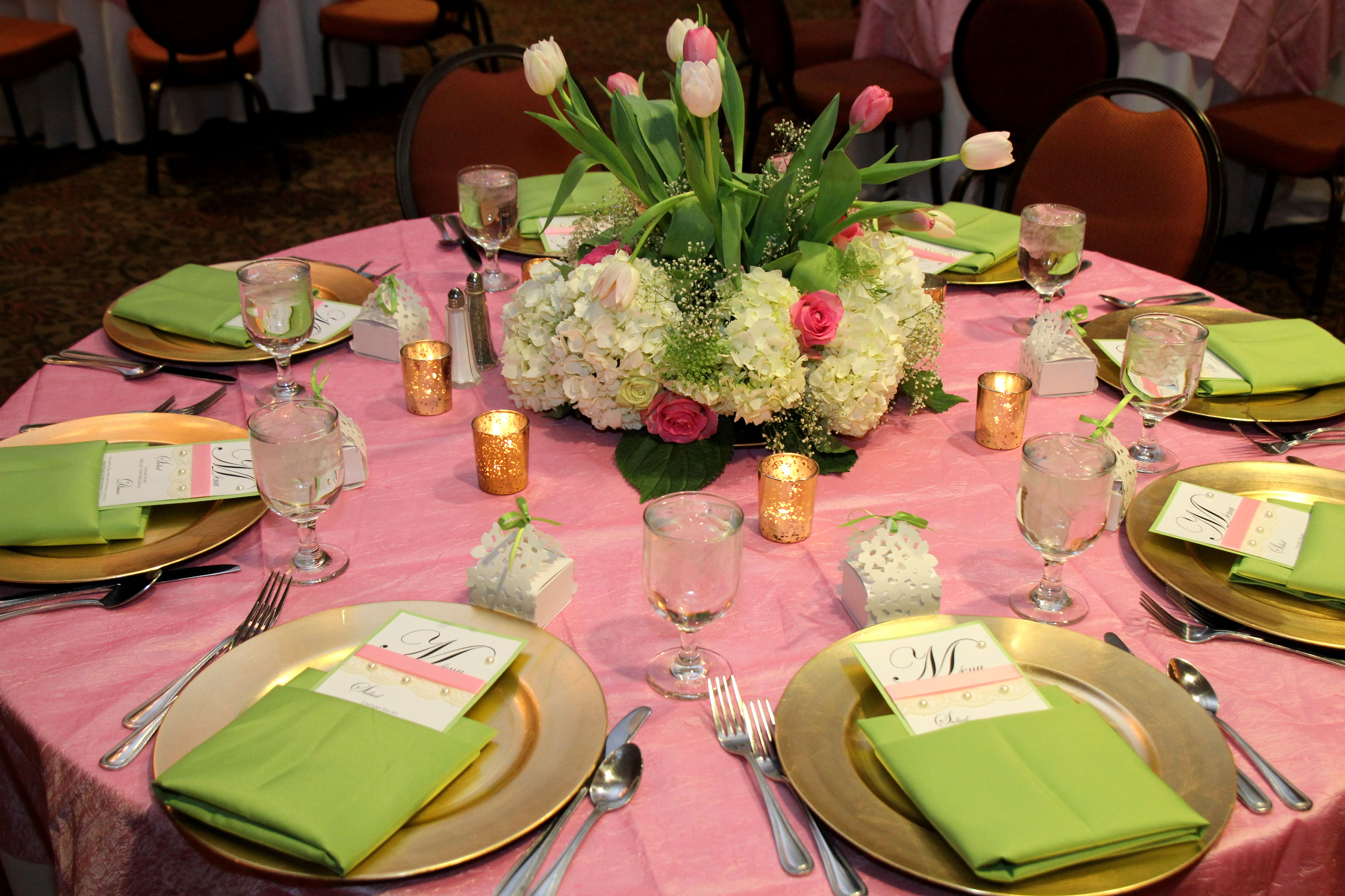 Pink and green table setting for 40th birthday party with spring