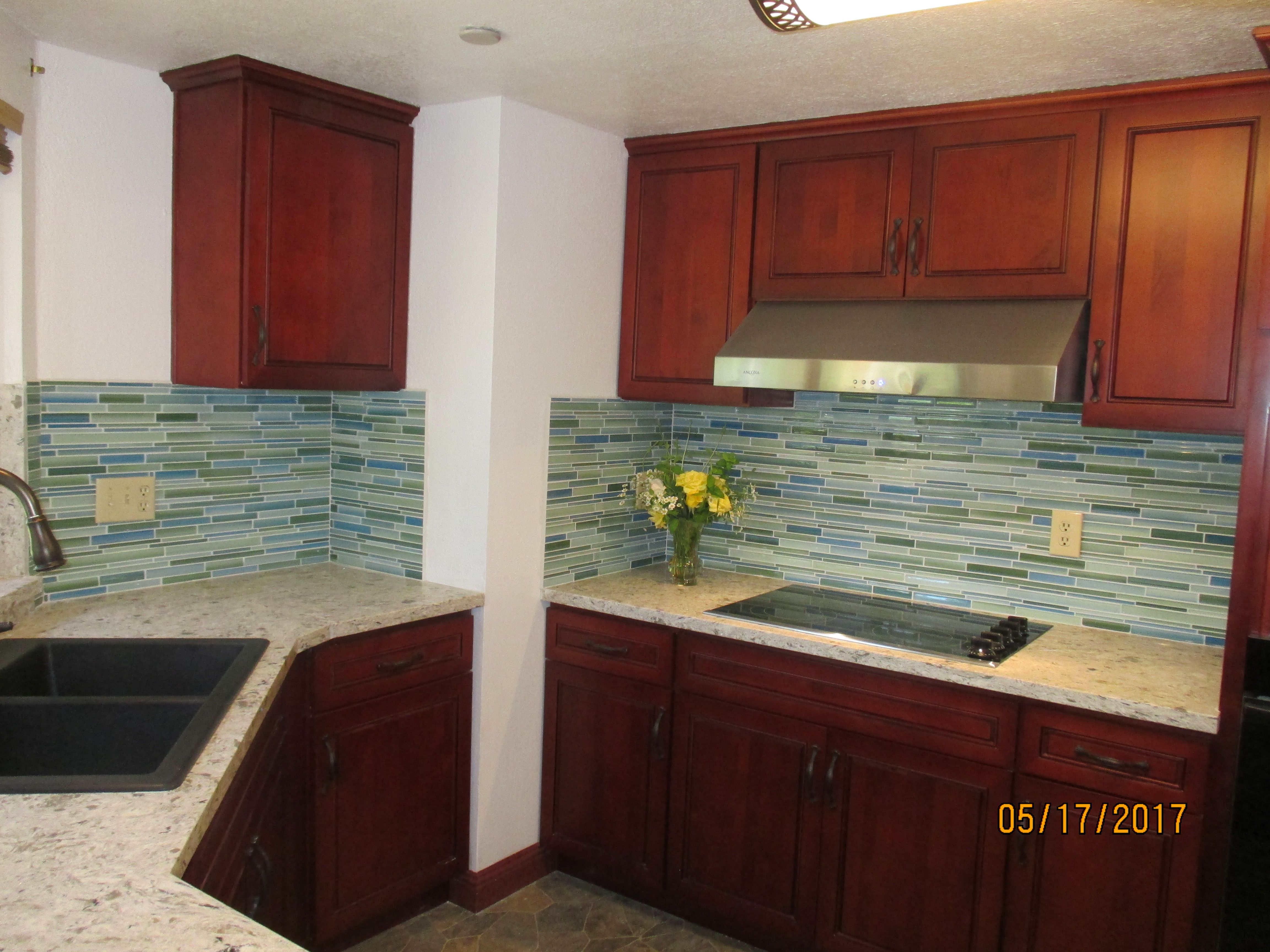 Curl linear glass mosaic tiles This Caribbean color bination of greens and blues brings a warm inviting feeling to a kitchen backsplash or bathroom