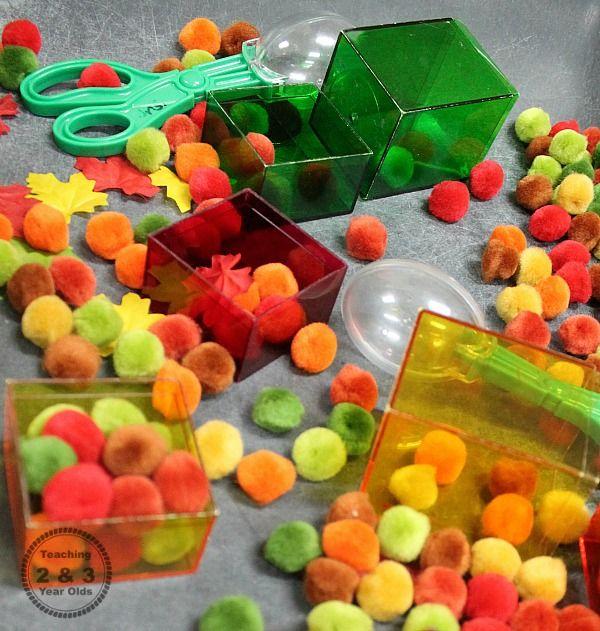 fall sensory bin with pom poms