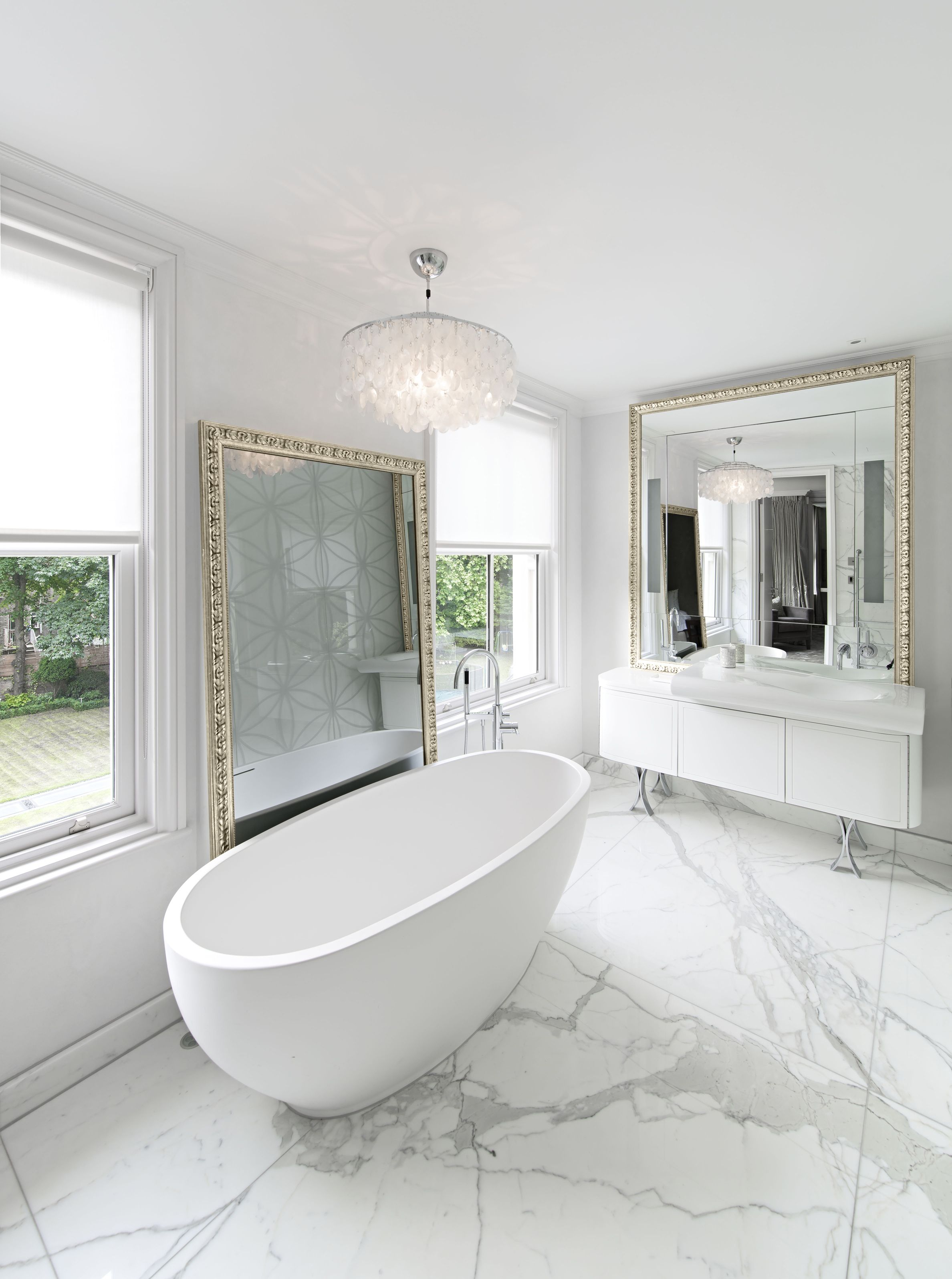 Bath freestanding on bookmatched calacatta oro marble for Bathroom floor mirror
