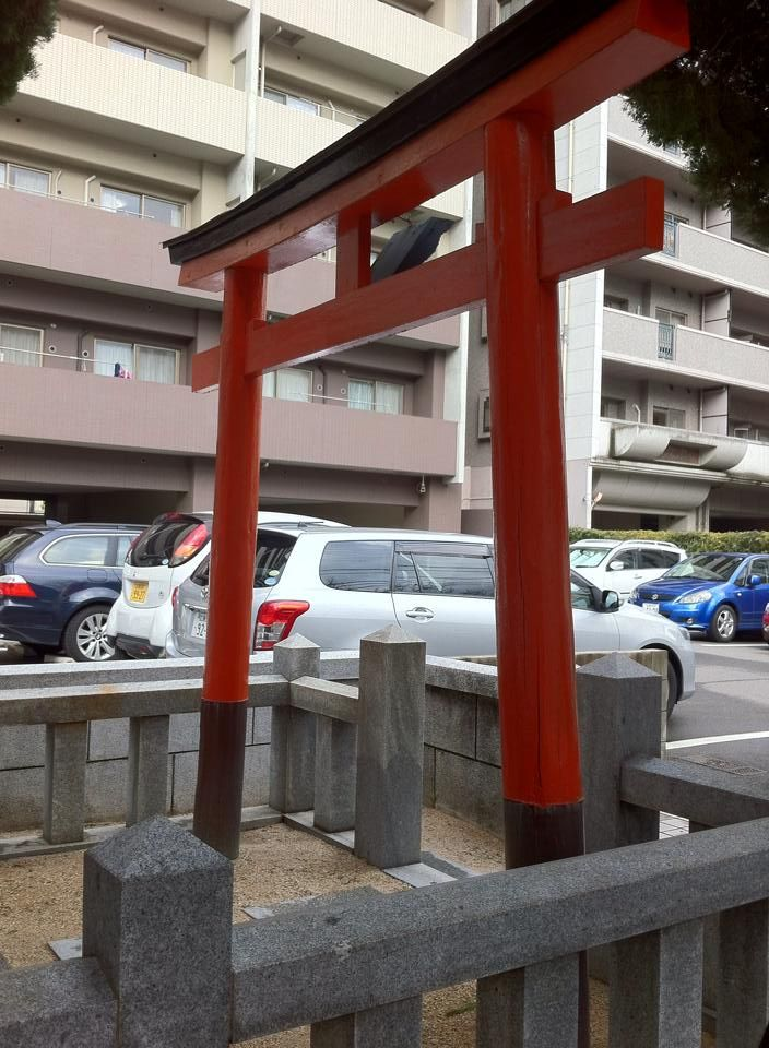 Small shinto shrine in the apartment parking.