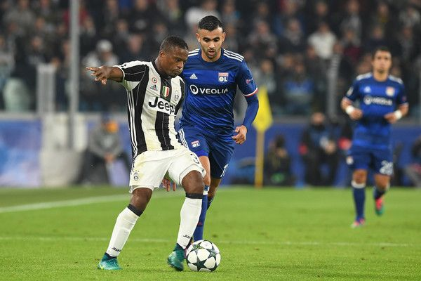 Patrice Evra (L) of Juventus in action against Rachid Ghezzal of Olympique Lyonnais during the UEFA Champions League Group H match between Juventus and Olympique Lyonnais at Juventus Stadium on November 2, 2016 in Turin, Italy.