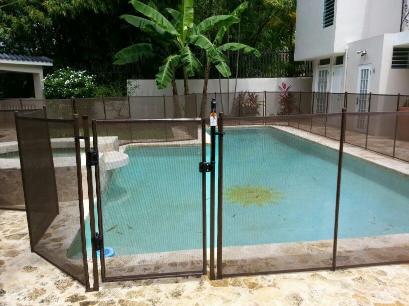 Brown pool fence and self closing gate