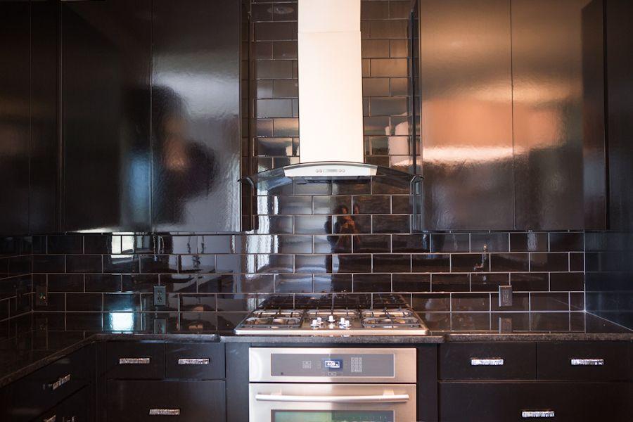black kitchen cabinets black subway tiles