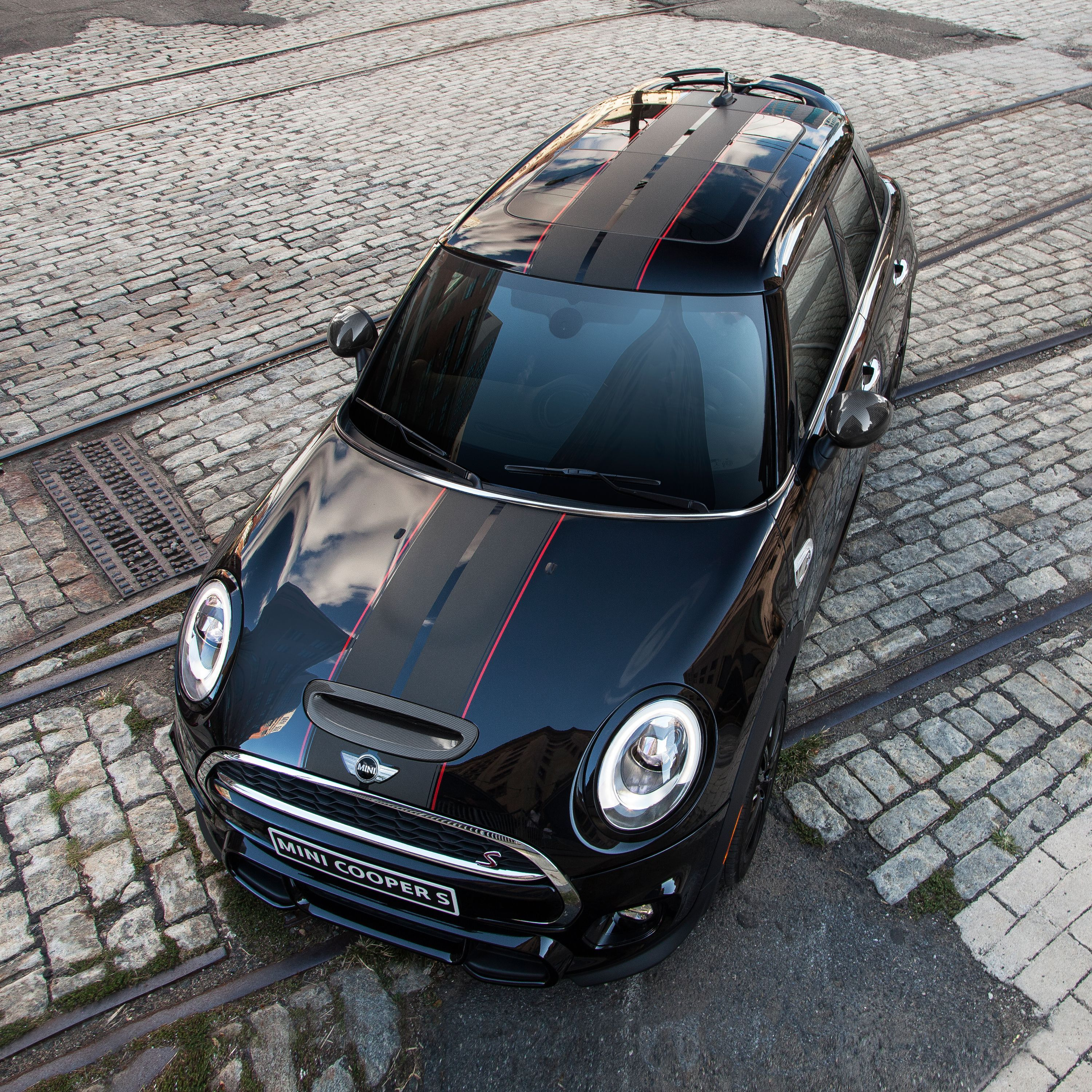 you can get bonnet or sport stripes on any mini shown here the carbon edition 39 s unique stripes. Black Bedroom Furniture Sets. Home Design Ideas